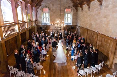 Bride walks up aisle at Achnagairn Estate