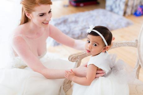 Bride with adorable little flower girl.