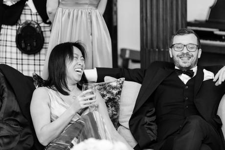 Black and white photograph of wedding guests having fun.