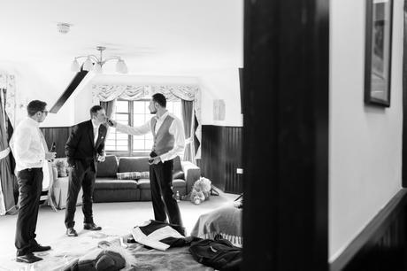 Groom and groosmen having fun getting ready for wedding
