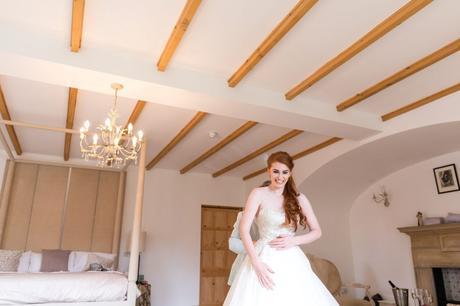 Redheaded bride being laced into wedding dress at Achnagairn Estate wedding