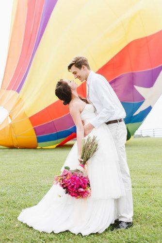 wedding exit photo ideas air balloon kiss Natalie Franke Photography