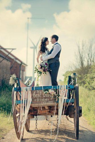 wedding exit photo ideas couple in coach with bouquet Dottie Photographys.us/katieandian