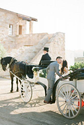 wedding exit photo ideas coach with horse kt Merry Photography