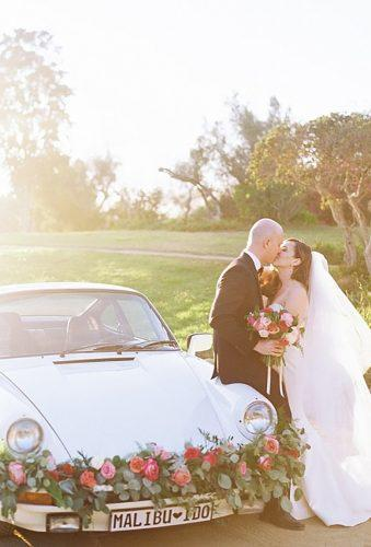 wedding exit photo ideas car with red flower Matoli Keely Photography