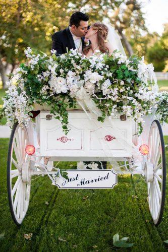 wedding exit photo ideas white coach with flowers Emma + Josh