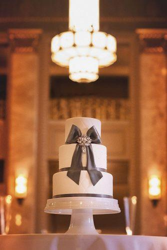 chic wedding cakes white vintage cake with a big black bow and rhinestones de la creme studio