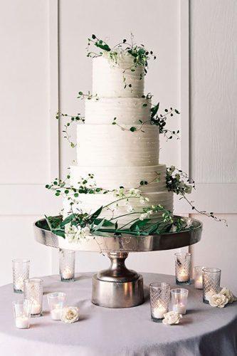 chic wedding cake with stylish greenery jose villa