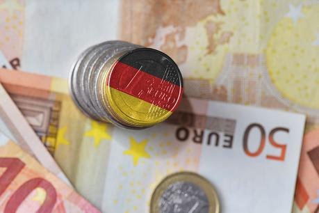 euro coin with national flag of germany on the euro money banknotes background. finance concept