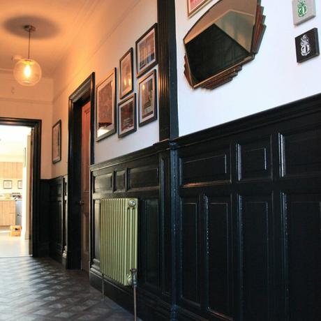 Gold column radiator in a dark hallway
