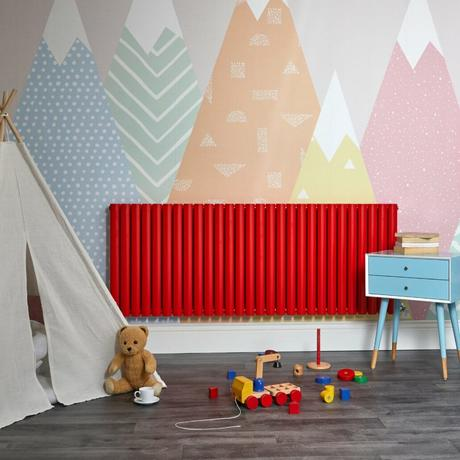 horizontal red radiator in a playroom