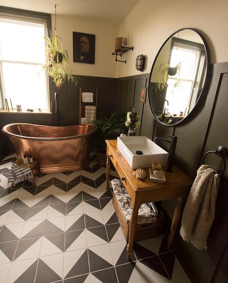 Bathroom inspiration - copper bathtub with monochrome patterned floor tiles