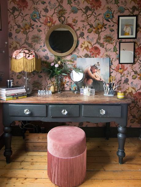 Vintage inspired, feminine dressing room decor with pink patterned wallpaper