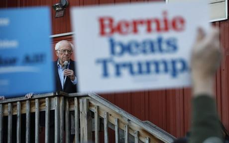 Bernie Sanders is seen speaking to an overflow crowd at a Super Bowl watch party campaign event on Feb. 2, 2020, in Des Moines, Iowa.