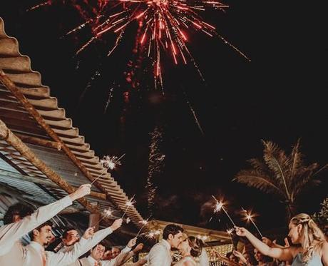 wedding party entrances ideas newlyweds kissing under fireworks