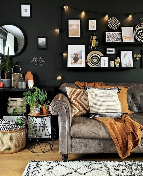 Black living room decor with quirky gallery wall inspiration, featuring out gold beetle wall decor