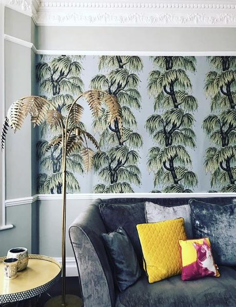 Tropical wallpaper in the living room, paired with our antique bronze palm leaf floor lamp