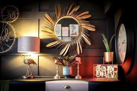 Dark and moody living room styled with our golden feather mirror