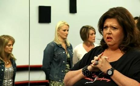 Dance Moms: She's Baaack! Abby Lee Miller Returns With Even More Mama Drama. Maddie Has A Melt Down, Mackenzie Falls Down & The Moms Just Throw Down. The Battle Begins.