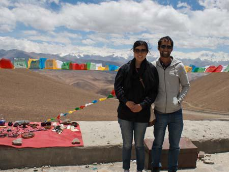 Sonya and Travis at Pang-la pass, the Himalayan Mountains visible in the background