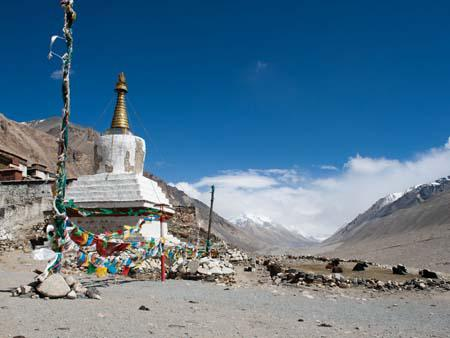 Chorten outside Rongphu the highest monastery in the world, in the background is a cloud covered Everest
