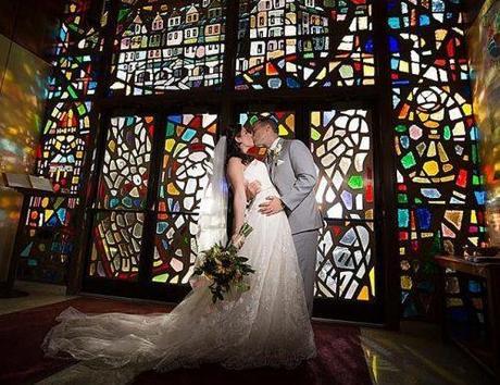 catholic-wedding vows bride and groom kiising