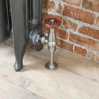 Milano Windsor thermostatic radiator valve entering a cast iron radiator