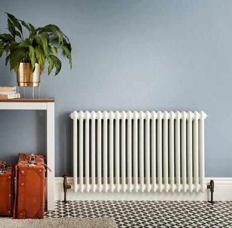 a white windsor radiator in a hallway