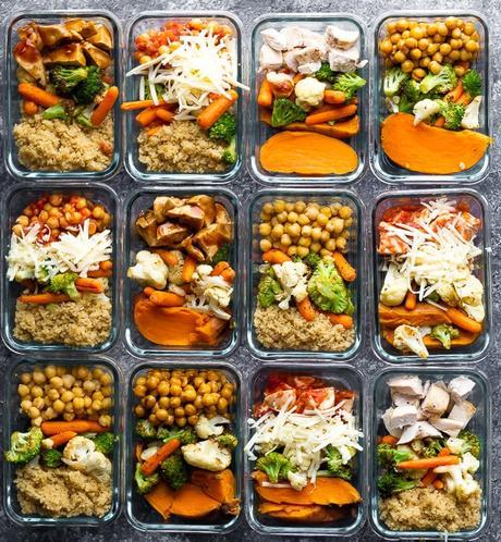 12 meal prep containers filled with cooked meals