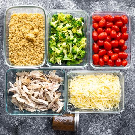 5 meal prep containers filled with prepped ingredients