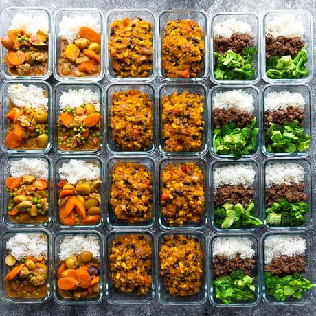 24 meal prep containers filled with cooked meals