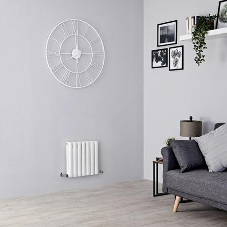 small white Aruba radiator in a small living room
