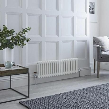 small low level Windsor column radiator in a small living room