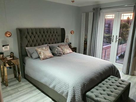 white Milano Icon radiator in a small gray bedroom