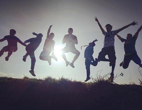 group silhouette jump shot