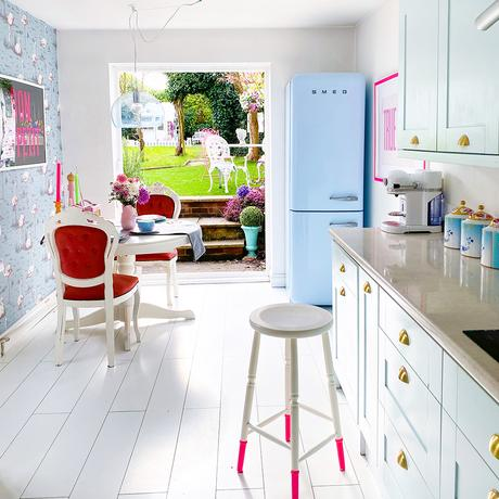 House tour of a fun family home - bright, fresh kitchen with pale blue cupboards and white floorboards