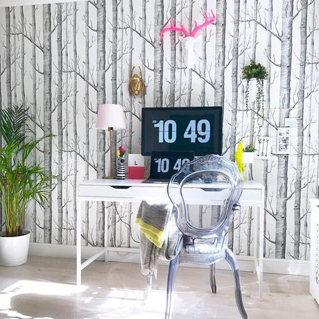 Home office with forest wallpaper