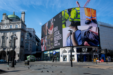 Billboards that normally display adverts in London's Piccadilly Circus carry signs thanking key workers.