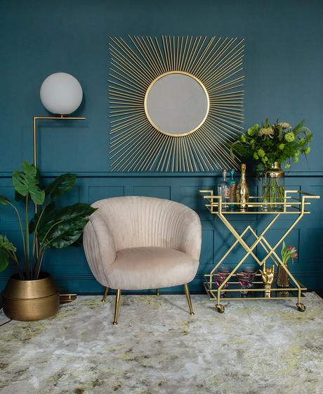 Art deco style interiors, Hollywood glam living room inspiration. Square sunburst mirror with art deco drinks trolley and blush pink velvet armchair