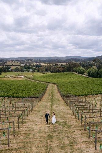 yarra valley elegant vineyard wedding drone photo with groom and bride rick liston