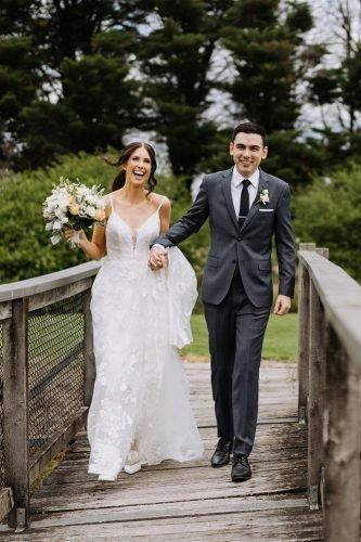 yarra valley elegant vineyard wedding happy groom and bride on bridge rick liston