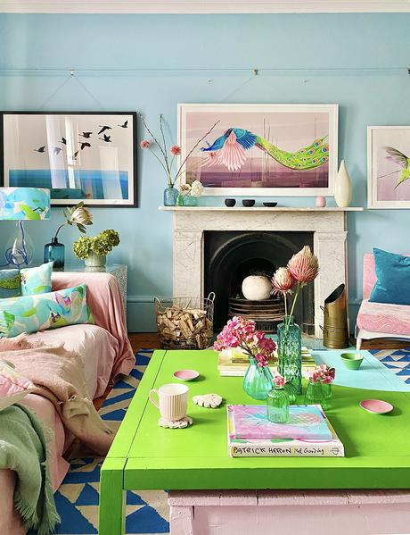 Quirky pastel blue living room with pops of green and blush pink