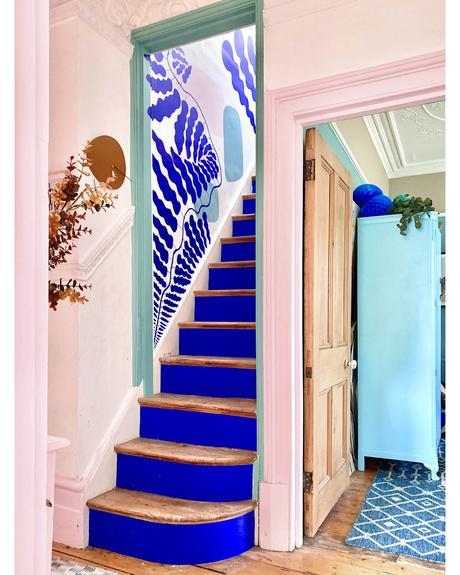 House tour of stunning London home with pastel hues and colourful wall murals - blush pink and cobalt blue hallway