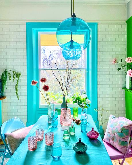 House tour of stunning London home with pastel hues and colourful wall murals - green and blue kitchen