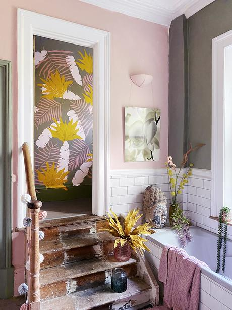 Blush pink bathroom with colourful wall murals