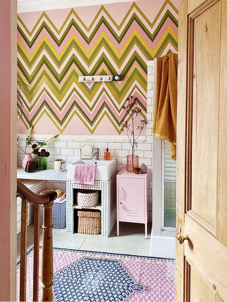 Pink bathroom decor with colourful zig zag wall mural