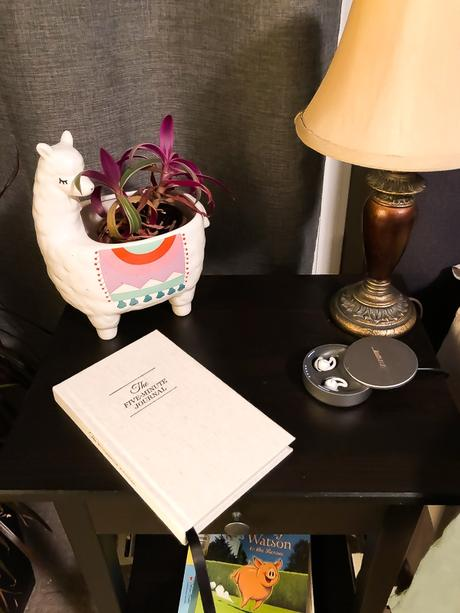 5 minute journal on bedside table