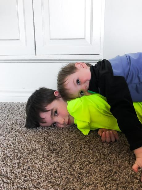 boys laying on top of each other