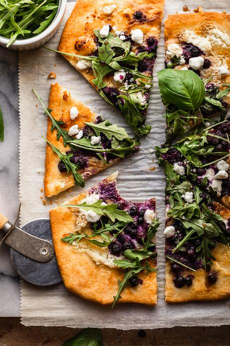 This gluten free pizza is loaded with wild blueberries, goat cheese and drizzled with balsamic reduction for just the right amount of sweet and tang! Blueberry balsamic goat cheese pizza is perfect for lunch or pizza night!