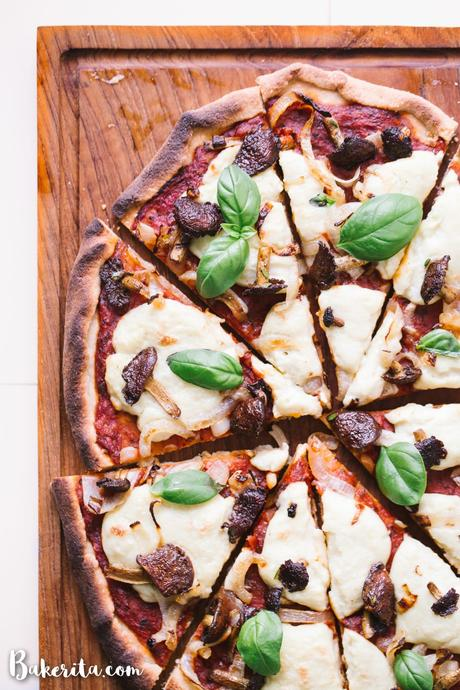 You'll be surprised at how easily this Gluten-Free Vegan Pizza with Mushrooms & Onions comes together! It is made with my new favorite gluten-free pizza crust and topped off with tomato sauce, homemade vegan mozzarella cheese, mushrooms and onions. Perfect for pizza night!
